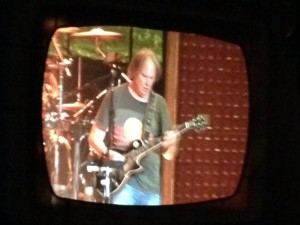 View of Neil Young off the jumbo video screen