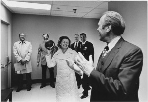 First lady Betty Ford tosses football to President Gerald Ford at Bethesda Naval Hospital in October 1974, following her surgery for breast cancer.