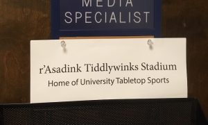 Sign reading r'Asadink Tiddlywinks Stadium - Home of University Tabletop Sports