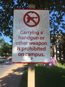 Sign on Maple Street in the University of Arkansas, still up after Sept. 1, 2017. Ben Pollock photo