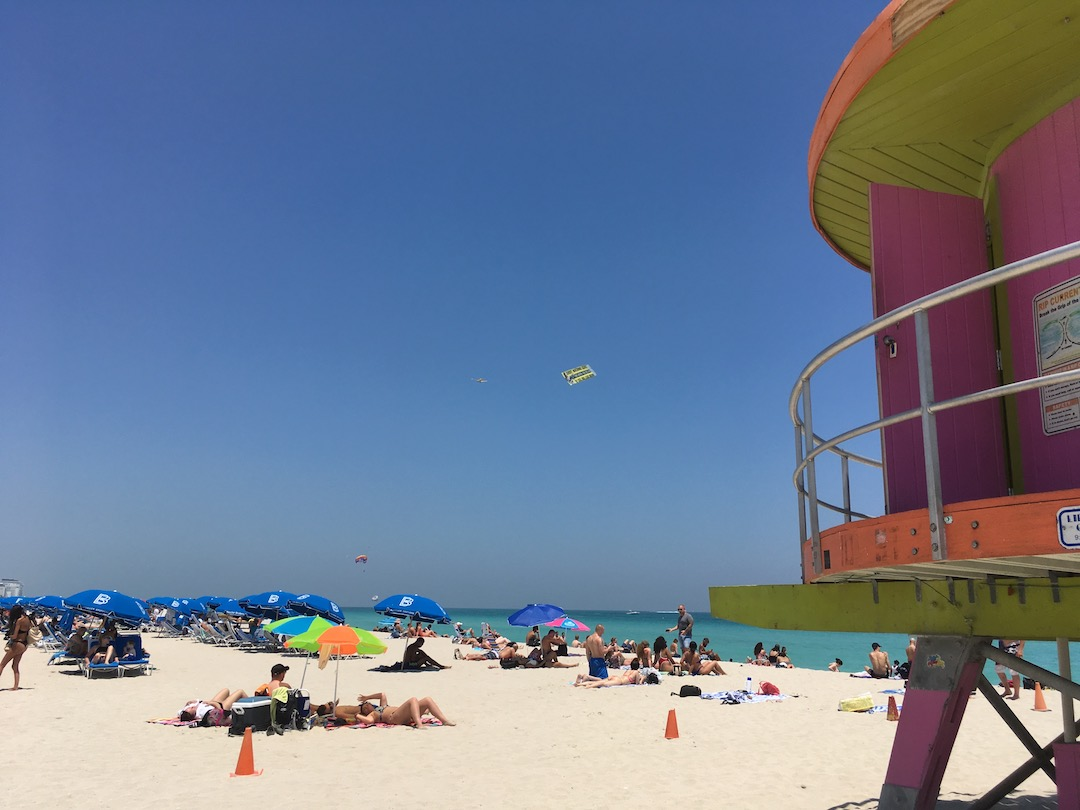 Plane tows a banner, advertising a gun range I think, above South Miami Beach.